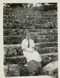Marion Blake sitting in the cavea of an ancient Roman theater in Italy