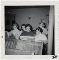 Members of the Class of 1962 sitting in classroom