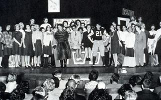 Students performing on stage in Chapin Auditorium, possibly in a Junior Show