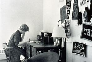 Student studying at a desk in her dormitory room