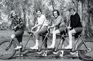 Students on a four-person bicycle