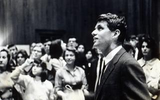 Crowd of students and others, with Robert F. Kennedy in the foreground