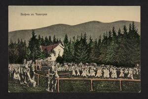 Postcard with an illustration of gathering of people by a house in the woods.