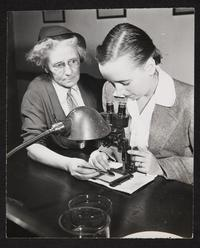 Professor of Zoology, Ann Haven Morgan, assisting student Betsy (Elizabeth) Kelsey '47 at a microscope