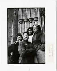 Four students posing on the steps of Abbey Memorial Chapel