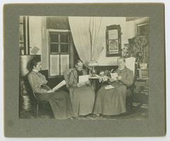 Grace Knapp '93, Mary Annie Ely '61, and Charlotte Ely '61, l-r, reading in the parlor of their mission home in Bitlis, Turkey