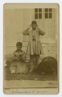 Three Mohammedan men at prayer in eastern Turkey, during the time of Charlotte and Mary A. C. Ely