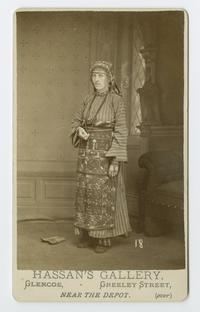 Woman dressed in traditional Armenian costume, with ornate apron and head covering, from the time of the Ely sisters' missionary work in eastern Turkey