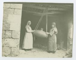 Two servant women churning butter for Charlotte and Mary Ely in Bitlis, Turkey