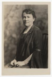 Portrait of Mary E. Woolley seated