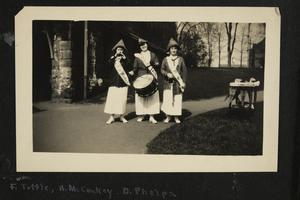 F. Tuttle, H.M. McConkey, D. Phelps, 3 woman with hats, sashes, and a drum