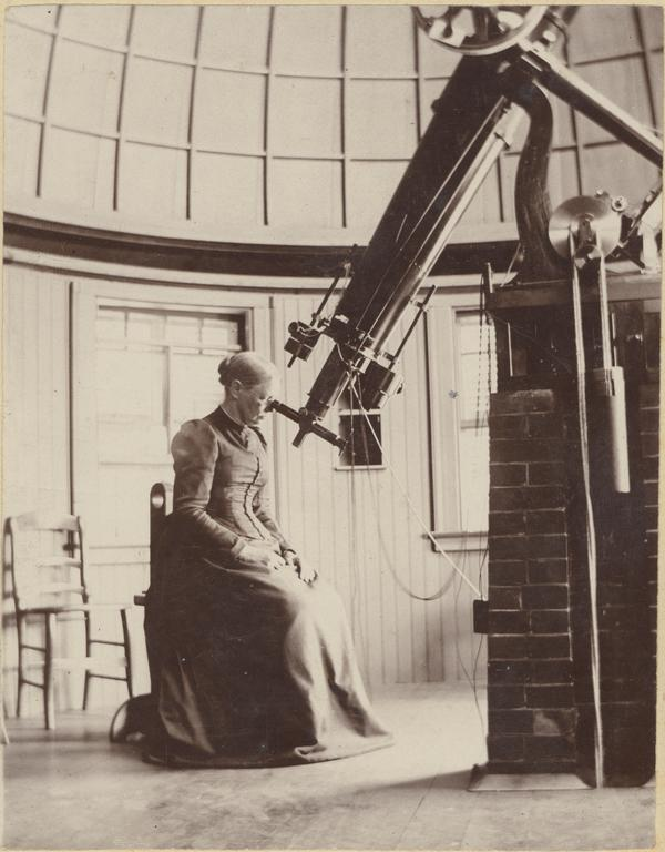 Professor Elisabeth M. Bardwell looking through a telescope