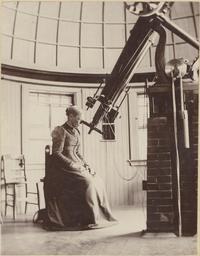 Professor Elisabeth M. Bardwell looking through a telescope