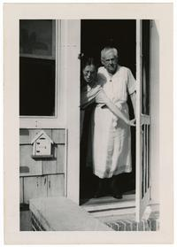 Photograph of the Clarkes at their front door