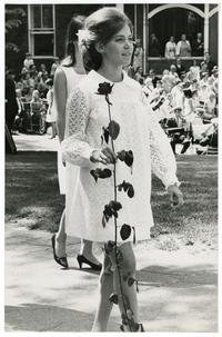 Ellen Sue Kipnis carrying a rose at Ivy Day