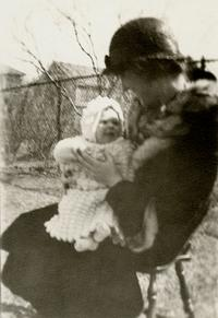 Baby Sylvia Plath sitting on her mother's lap