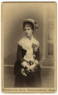 Salome Machado (Class of 1883) in flowered bonnet holding a bouquet