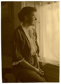 Mary Byers Smith (Class of 1908) looking out a window