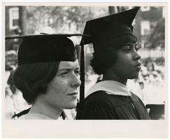 Hazel L. Martin and another student in cap and gown