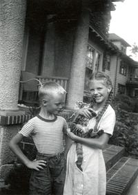 Warren and Sylvia Plath holding a cat