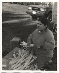 Katsi Cook shucking corn
